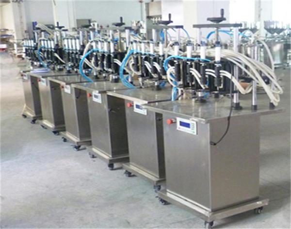 Аутоматска машина за пуњење боца за парфеме